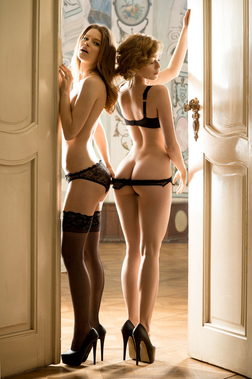 Two Beautiful and Hot Blonde Posing in the Doorway