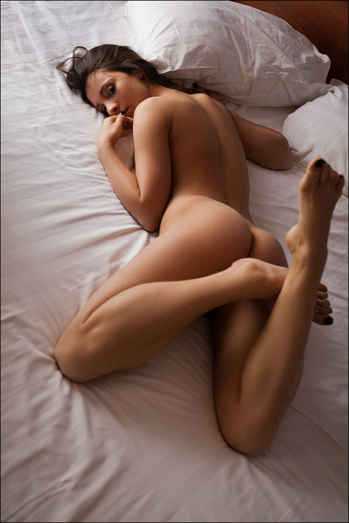 Young Girl in Bed With a Beautiful Little Ass