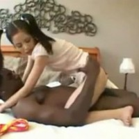 Small Asian teen girl is tasting the huge black cock