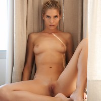 Hot blonde shows her shaved pussy