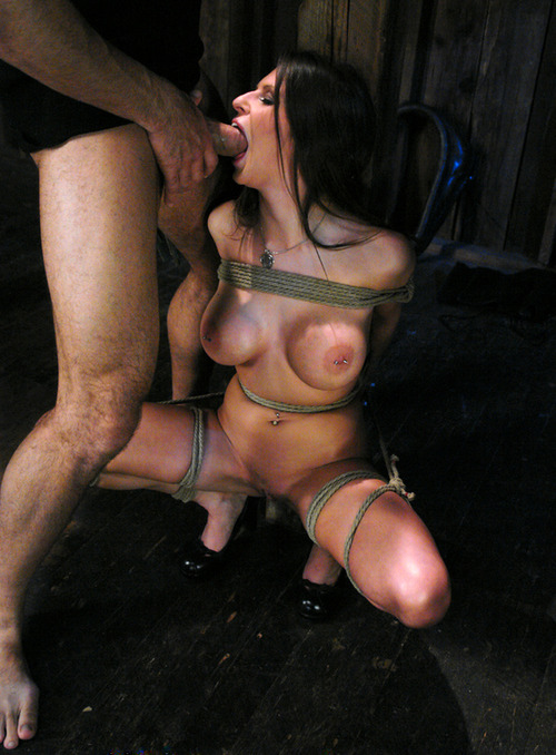 Busty brunette tied with ropes blowjob