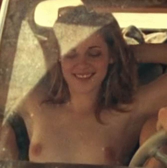 Cute boobies of Kristen Stewart topless in car