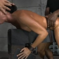 Slave oiled up brunette whore gets fucked in threesome